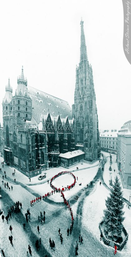 Flashmob: People building a Red Ribbon at the Stephansplatz beside the Stephansdom