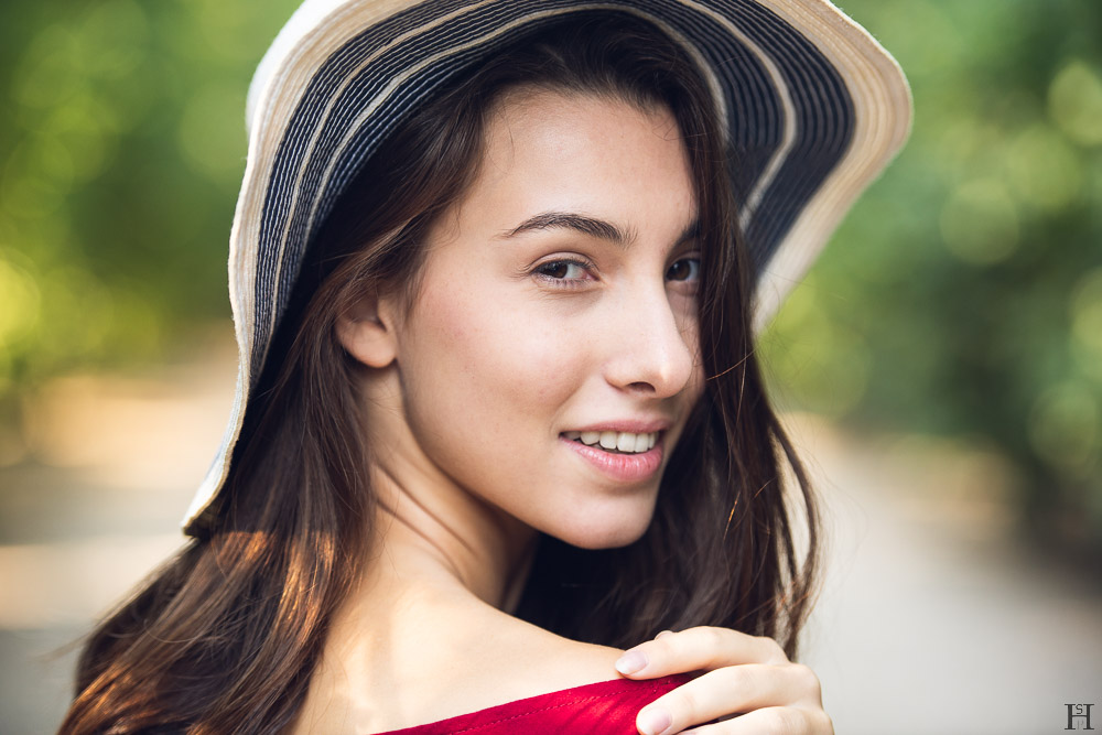 pretty young girl with hat in a park